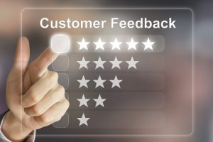 41192688 - business hand clicking customer feedback on virtual screen interface