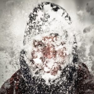 17527521 - silhouette of a man in heavy snow storm.