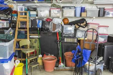 53109810 - garage filled with various home storage items.